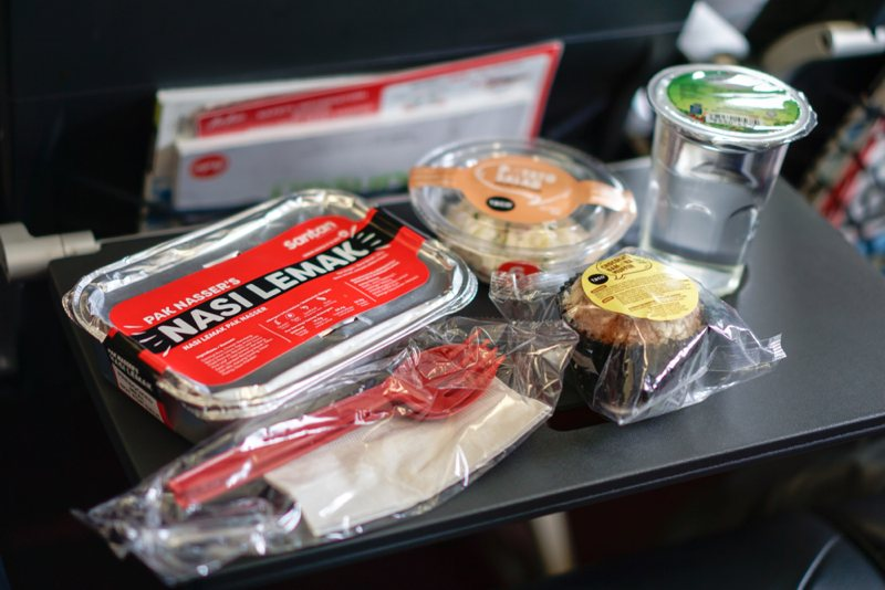 Many inflight meals are still wrapped in plastics because they are cheap, light, and can lessen the chance of contamination